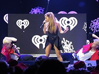 Singer Ariana Grande now requires photographers to transfer full image copyrights