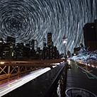 Composite timelapse combines Death Valley's night sky with New York City's streets