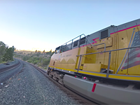 Master drone pilot captures video while flying around, inside, and under a moving train