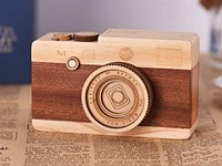 This wooden Leica is a covert music box with rotating 'lens'
