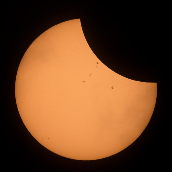 NASA captured photos and video of the ISS 'photobombing' today's solar eclipse